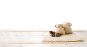Two of blank hemp sack bag and pine cones on wood table top floo Royalty Free Stock Photos