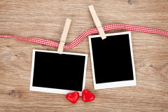Two blank instant photos with candy hearts Royalty Free Stock Images