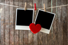Two blank instant photos hanging on the clothesline royalty free stock images