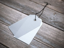 Two blank labels with string on the floor. Royalty Free Stock Images