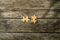 Two blank matching wooden puzzle pieces Stock Photos