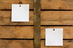 Two blank notes. Two pieces of blank paper tacked to wooden background.Ready for your text Stock Photography