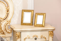 Two blank photo frame on the chest of drawers Stock Image