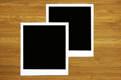 Two blank photo frame on wooden background Royalty Free Stock Image