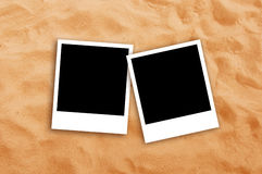 Two Blank photo frames on beach sand. Texture. Copy space for your images Stock Photos