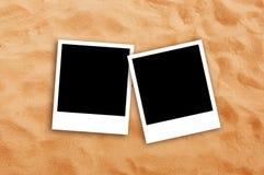 Two Blank photo frames on beach sand Stock Photos