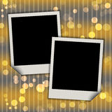 Two blank photo frames on festive bokeh background Royalty Free Stock Photos