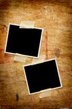 Two blank photos. On a grungy wooden background Stock Photos