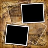 Two blank photos. On a grungy paper background Stock Photography