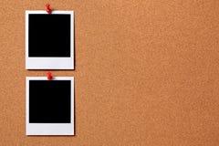 Two polaroid frame photo prints cork background copy space Royalty Free Stock Image