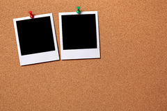Two blank polaroid frame photo print cork background copy space. Two blank polaroid photo prints pinned to a cork notice board.  Space for copy.  Paths provided Stock Image