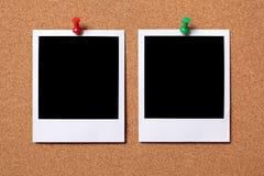 Two blank polaroid frame photos cork background Stock Photos