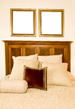 Two Blank Picture Frames Over Bed Stock Image