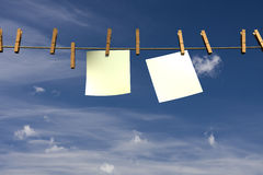 Two blank pieces of paper hanging on a rope Stock Photography