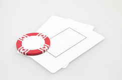Two blank play cards with casino chip Stock Photo