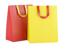 Two blank red and yellow shopping bags isolated on white Stock Photography