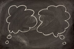 Two blank speech bubbles on blackboard Royalty Free Stock Photo
