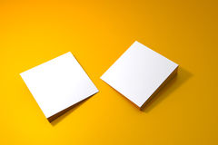 Two blank square board on yellow surface Stock Photos