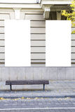 Two blank vertical mockups of light boxes on a building wall. Autumn street. Front view Royalty Free Stock Image