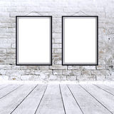 Two blank vertical paintings poster in black frame. Two blank vertical painting poster in black frame hanging on white brick wall. Painting proportions match royalty free stock photography