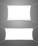 Two blank white banners with copyspace. Two blank white textile banners with copyspace suspended by ropes by all four corners and stretched tight hanging royalty free illustration