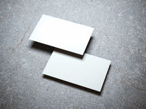 Two blank white business cards stock images