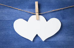 Two blank white hearts over wood wall Stock Photography