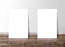 Two blank white paper template banners on the wooden floor Stock Photo