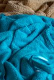 Two blankets lying side by side in blue and brown royalty free stock image