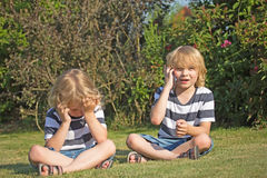 Two blond boys in the garden. Royalty Free Stock Photo