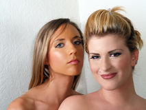 Two blond caucasian women bare shoulder portrait. Two young caucasian women bare shoulder portrait Stock Photography