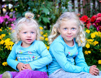Two blond girl sitting stock photo