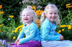 Two blond girls smiling Stock Image