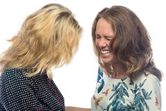Two blond laughing women. On white background Stock Photo