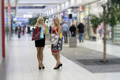 Two blond shopping woman Royalty Free Stock Photo