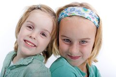 Two blond sisters. Portrait of two blonde haired sisters looking into the camera Stock Photos