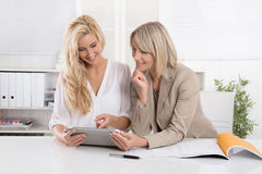 Two blond successful attractive businesswoman working in a team Royalty Free Stock Image
