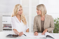 Two blond successful attractive businesswoman working in a team Royalty Free Stock Photo