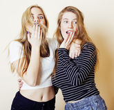Two blond teenage girl fooling around messing hair. Girls friendship Royalty Free Stock Photos