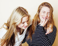 Two blond teenage girl fooling around messing hair. Girls friendship Royalty Free Stock Images