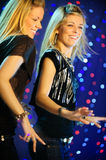 Two blond twins  girls dancing. Vertical image of two blond girls dancing Royalty Free Stock Images