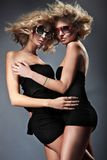 Two blond women. Wearing sunglasses Stock Image