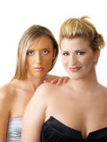 Two blond women bare shoulder portrait white. Portrait of two blond women with bare shoulders Stock Photography