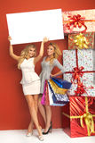 Two blond women with plenty of gifts. Two blond ladies with plenty of gifts Stock Photography