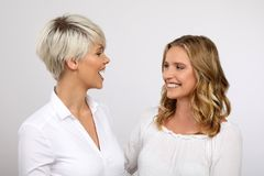 Two blond women smiling. Two young blonde women having fun Stock Photo