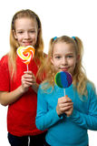 Two blonde girl with lollipop Royalty Free Stock Image