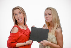 Two blonde girls holding blank chalkboard Stock Image