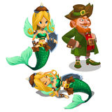 Two blonde mermaids and a man leprechaun Stock Image