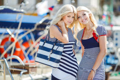 Two blonde near Yacht Club Stock Photo