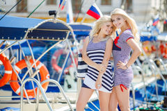 Two blonde near Yacht Club Stock Image